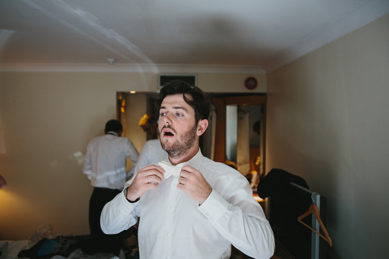 Creative wedding photography, groom preparation