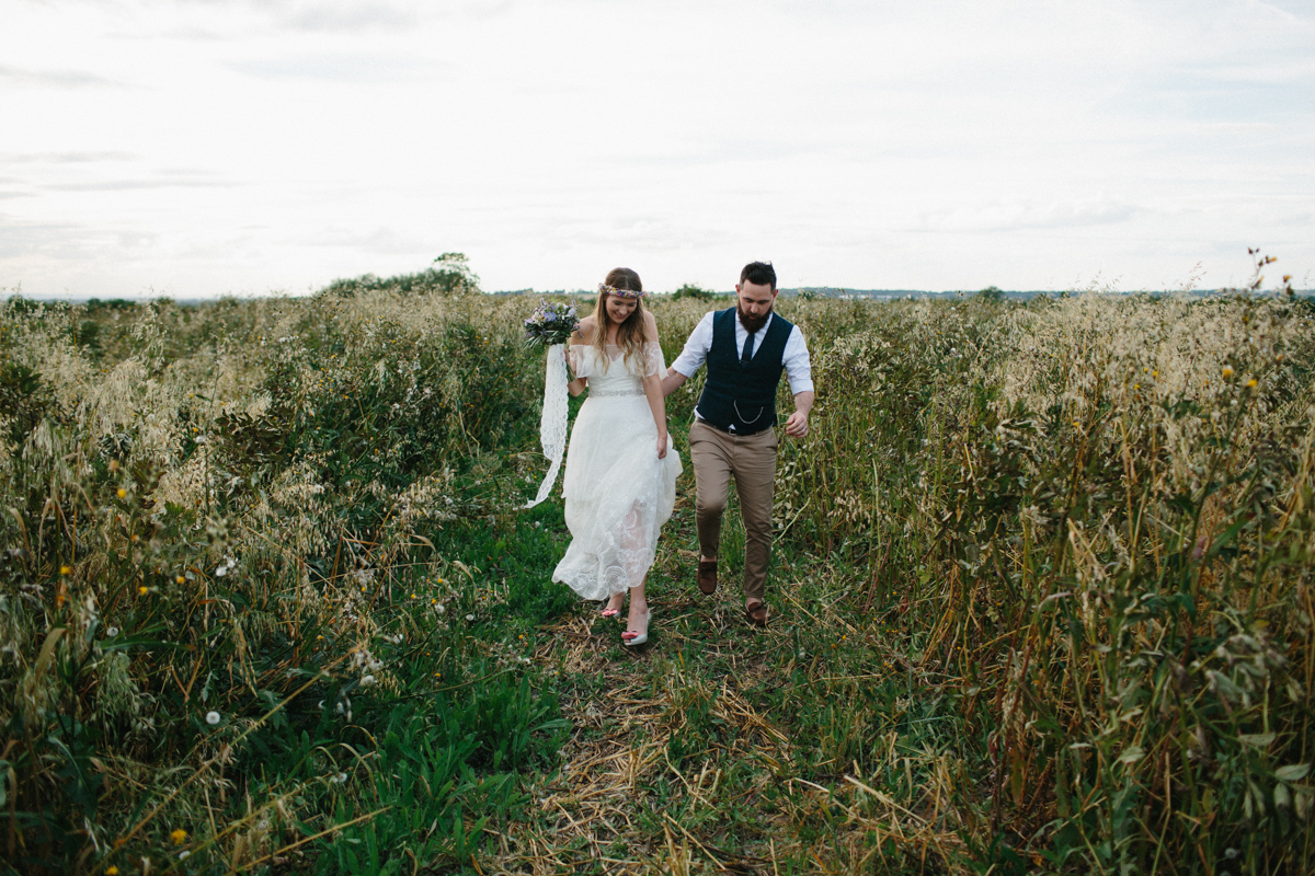 Country Wedding bride and groom in a field