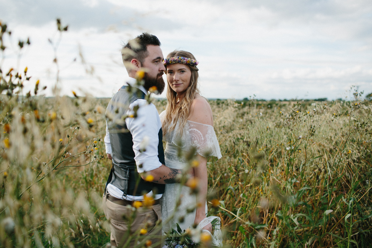 Country Wedding couple in a field