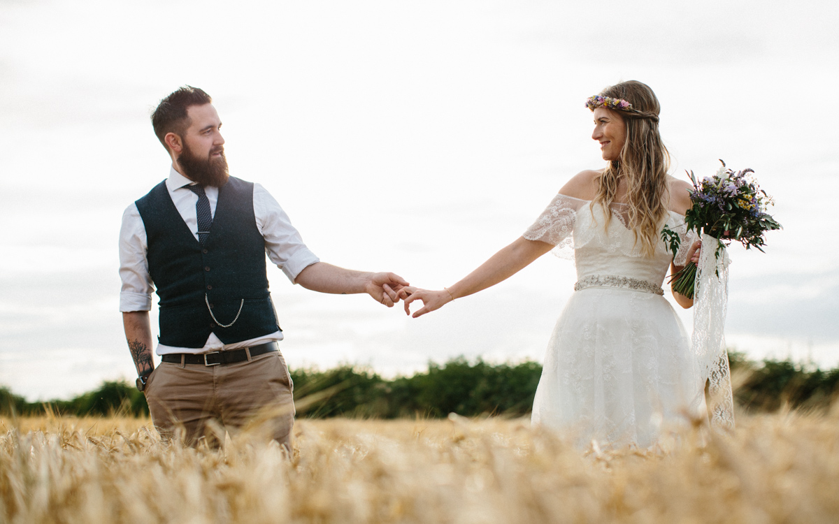 Bride and Groom in a field at sunset - Country Wedding